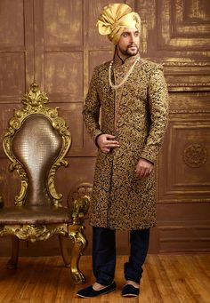 Buy Utsav Fashion Golden And Blue Embroidered Achkan Sherwani online in India at best price.Buy Embroidered Brocade Sherwani in Dark Blue and Golden online,Item code: Occasion: Wedding, Sherwani For Men Wedding, Wedding Dresses Men Indian, Groom Wedding Dress, Groom Dress, Wedding Wear, Wedding Suits, Ethnic Wedding, Tuxedo Wedding, Indian Weddings