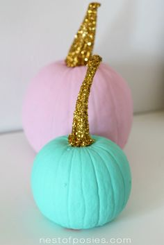 Spray Painted Pumpkins with Gold Glitter Stems. Aren't they fun?