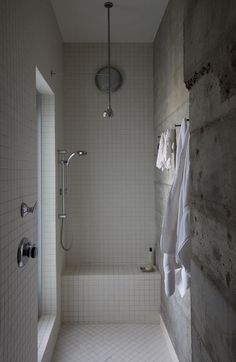 Bolts used as hooks in shower, plus I love the concrete walls and super simple showerhead