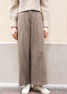 """#newarrivals #taupe #highwaisted #stiched #wideleg #pants #thefrankieshop #frankienyc #frankiegirl High Waisted Wide Leg Wool Pants w/Partial Elastic Waist & 2 Slit Side Pockets Snap Button & Zip Front Closure. Inner Drawstring at Waistline Partial Elastic Waist & Partial Lining Stitching Color- Grey/White/Mustard/Blue 27.5"""" Inseam, 13"""" Rise, 26-28"""" Waist Dry Clean Imported"""
