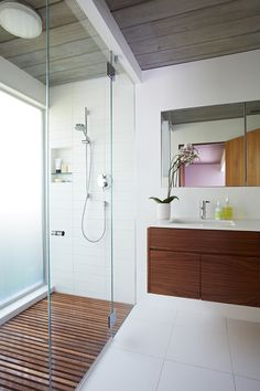 The larger master bathroom was reoriented and updated with new materials—the same ones that have been used throughout the house including walnut and the Western red cedar siding.