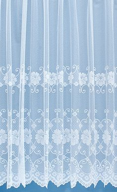 Somerton is a very finely woven net curtain. The pretty floral scalloped bottom is intricately designed adding feminine charm to the otherwise unadorned net.