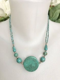 Beautiful statement coin turquoise necklace, centre piece 28mm round coin turquoise bead (4mm depth), necklace decorated with 7mm round beads with silver capstone silver findings and daisy rings,, 6mm smaller round beads, 10x3mm tube beads, double line of tiny Nepalese traditional beads #necklaceideas