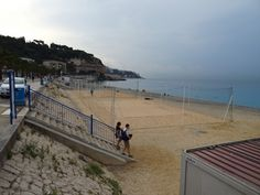 The only sand on the beach was on the volley ball courts  at Nice, France. Early morning before the crowds arrived