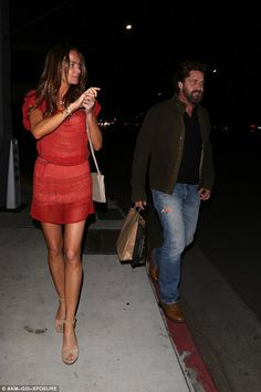 Red hot:The actor's leading lady sizzled in a flirty red mini dress that cinched into her waistline and showed off her envy-inducing long legs