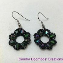 Green+crystal+beads+and+black+glass+seed+bead+flower+dangle+earrings.+Made+with+silver+plated+non+tarnish+hypoallergenic+materials.