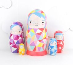 Such pretty little geometric modern Russian dolls. I love their concentrating expressions.
