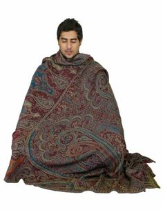 This large size (55 x 106 inches) shawl is meant for keeping yourself comfortable during prayers or meditation or yoga. When you are seated in meditation posture, you can cover yourself fully with this shawl. This shawl alternates very well, were you to use it as yoga blanket. The fabric is thick, almost like a blanket, yet much lighter. It is made in natural wool with beautiful paisley designs and patterns woven within the fabric. This shawl cum blanket looks elegant and is very functional