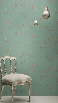 The English Robin Wallpaper A jade green wallpaper with robins sitting on branches.