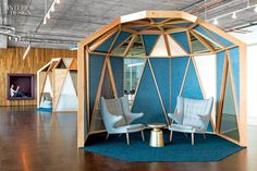 WiFi pioneers now work for Cisco, at a high-energy San Francisco office by Studio O+A. Shown: In a break-out area, a custom enclosure's fram...