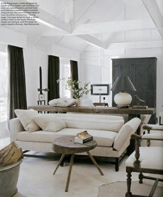 Lake or farm cottage with rustic wood, black and airy white and space.  Darryl Carter.