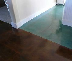 Stained concrete flooring for the laundry room and storage room. Love the turquoise