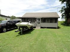 144 Grays Camp Ln - Nice cabin at Reelfoot Lake.  Perfect for the Sportsman  Dont let the sq footage fool you - this place has so much to offer.   Lovely enclosed front porch to sit and watch an array of wildlife that Reelfoot lake provides.  This home comes fully furnished and is Move-In Ready  Included in the sale is a new boat (16K and only used 2x) with its own 8x16 boat shed around back to place it in after a day out on the lake.  Tractor May Be Included  Attic Access Through Pantry in…