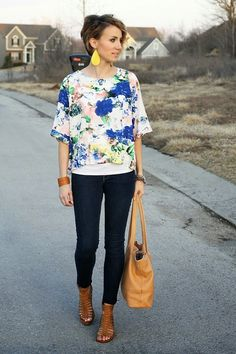 ONE little MOMMA sports this Floral Drape Top from Woodbury Lane paired with leather details.