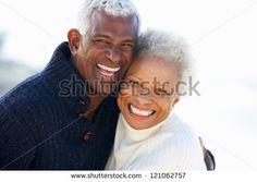 Romantic Senior Couple Hugging On Beach - stock photo