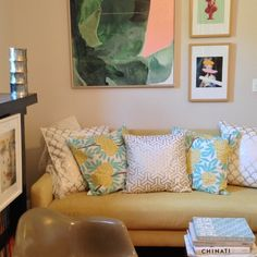 A good gallery wall has a mix of paintings, photographs, new and old finds.