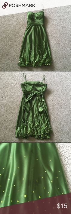 [SALE] Short Homecoming Dress Beautiful olive green satin-like short embellished dress purchased at Dillard's. Only worn once, in great condition other than a few oil stains as pictured (I tried to eat fried rice at a Hibachi grill with chopsticks... not my brightest idea lol) Stains not noticeable in most lighting and are on the bottom half of the dress anyways. Zipper in back and ties behind the back. Make me an offer ☺️ Jump Dresses Mini