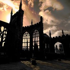 Coventry Cathedral ruins still stand today. The 14th century cathedral was bombed during the WWII; the new Coventry Cathedral was built not far from these ruins, a poignant reminder of human self-destruction
