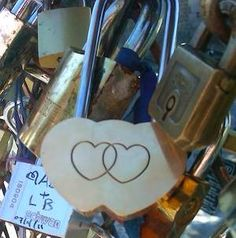 Paris honeymoon. A couple writes their names on a padlock and locks it onto one of the bridges. They then throw the key into the Seine River as a symbol of their undying love. How romantic would that be?