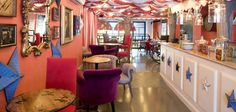 """A magical meeting place for the young in Barcelona is this café called """"Pudding"""". Painted to look like a circus and Alice and Wonderland, it's become a fairy tale like world where children can have fun, read books and do their homework. #color #travel #world #colorful #barcelona #pudding"""