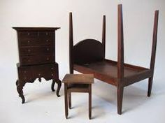 Tynietoy dresser, four poster bed and telephone table.