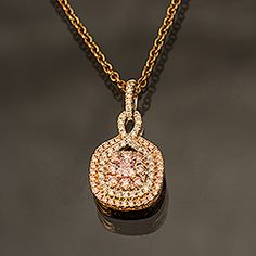 Diamond & Pink Diamond pendant in 18k rose & white gold. Diamond accents: .19ct Pink Diamond accents: .34ct Pink Diamond center: .14ct