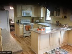 """16610 14th Avenue N, Plymouth, MN 55447 — A must see 5 bdrm 4 """"bath"""" in a lovely neighborhood cul-de-sac. 3 living spaces, beaut. deck overlooks pool & pond in park like setting w/a trail at edge of property to the Luce Line. Newly remod. kit, wood & tile flrs, roof, wndws & deck.Wayzata schools."""