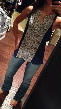 Cute tank- long, a little loose, but still fitted enough to layer! KW
