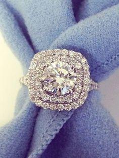 Cushion shaped double halo engagement rings