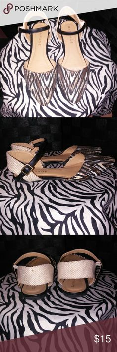 Rampage Sandals Cute, cute, cute. Comfy flats, in a beautiful abstract pattern of browns, tan , and black. Made if fabric type if material. Great condition. Rampage Shoes Sandals