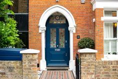 Extra wide Victorian front entrance door and frame. this door fits perfectly under an arch. Its polished chrome furniture shine out among the rich blue. The intricate lead glass adds to it being picture perfect - Cotswood Doors
