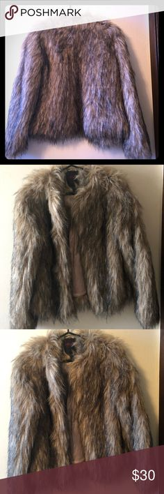 Yoki NY Faux Fur Coat Beautiful mixed black & brown faux fur. Worn once and decided it's really not my style. Polyester lining feels like satin, warm and comfortable.  No signs of wear. Jackets & Coats