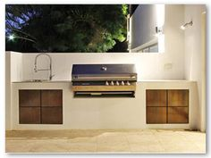 Outdoor built-in grill, counter and sink, brightly lit with selectively directed lighting. Home, Outdoor Kitchen Design, Outdoor Rooms, Modern Outdoor, New Homes, Outdoor Dining, Outdoor Cooking, Outdoor Design, Outdoor Kitchen