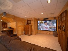 "All Things Considered - Wooded Mountain View - Sit back and relax in your 3 bedroom cabin watching your favorite movie or game on the 110"" big screen home theater system!"