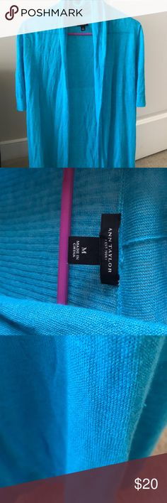 Turquoise linen cardigan Ann Taylor short sleeve cardigan that is made of 70% linen and 30%rayon. Pairs perfectly with a sundress or over a bathing suit. Not worn much..a few minor snags Ann Taylor Sweaters Cardigans