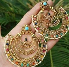 Handmade brass hoop earrings with multi-colored stones and beading
