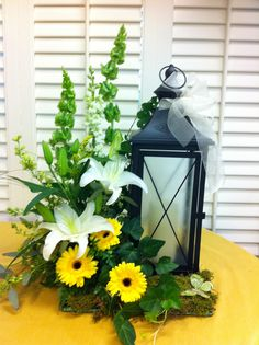 Lantern and Lilies -- a beautiful way to send a light of hope.  This one in particular is a sympathy design.