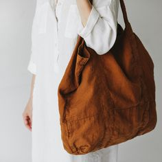 Discover Biome's slow fashion range - ethical fashion brands that are doing their bit for sustainability. Shop Kowtow, Mosov Organic, Seaside Tones, and more. Colour: mustard Made from soft Baltic linen. Le Tote, Diy Tote Bag, Tote Bags, Sac Lunch, Ethical Fashion Brands, Linen Bag, Slow Fashion, Fashion Blogs, Knitted Bags