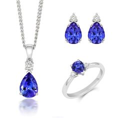 18ct White Gold Tanzanite Diamond Three Piece Gift Set, TVN-351 The pieces that comprise this exquisite gift set feature beautiful Tanzanite gemstones, discovered in the Mererani Hills of Northern Tanzania. They are an embodiment of elegance and luxury with Tanzanite being one of the world's most desired stones. This seductive gemstone can exhibit a variety of surreal colours including blues, violets and burgundies so each piece is truly unique and beautiful.  Ring: Tanzanite 0.65cts… Tanzanite Gemstone, Christmas Gift Sets, Latest Jewellery, Rose Gold Jewelry, Jewelry Packaging, Gold Chains, Natural Gemstones, Jewelry Gifts, White Gold