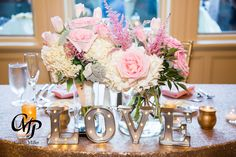 I was able to reuse flowers from my ceremony on my sweetheart table! #sweethearttable #lovesign #pinkflowers #pink #gold #pinkandgold #roses #tulips #sequins #sequinlinen @erlo