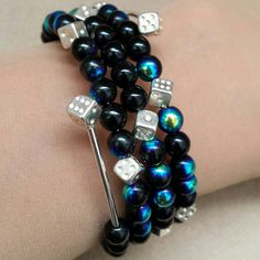 Check out this item in my Etsy shop https://www.etsy.com/listing/212534780/black-glass-beads-and-dice-rockabilly