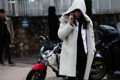 Ece Sukan talking on the phone after the Loewe Fall/Winter 2016-2017 fashion show in Paris, France