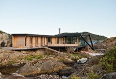 Exterior, House Building Type, Cabin Building Type, Flat RoofLine, and Green Roof Material Photo 3 of 11 in A Norwegian Summer Cabin Embraces the Rocky Terrain Tromso, Lund, Summer Cabins, Norway Landscape, Haus Am See, Modern Cottage, Waterfront Homes, River House, Modern Exterior