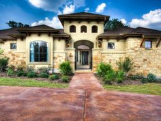 Hill Country Modern Front Elevation By Zbranek Holt Custom Homes - Luxury home builders san antonio