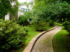 concrete paver walkway to bisect a sloped yard--really pretty solution