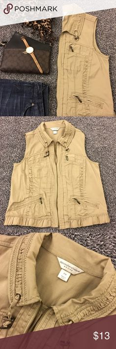 Tan utility vest - hardly worn! I hardly wore this so its in great shape and comes from a smoke free home! See pictures for details and condition! Tag says petite but it can work for regular as well! Bust measures 19 in. flat. Hips are nearly 20. Length is 22 in. Four functional front pockets. Great gathered details. Versatile and comfy! Great for layering! Questions? Ask me! I price for negotiation so feel free to make an offer! Bundle and save as well with 20% discount! No models or…
