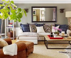 fig plant. white sectional. ethnic print pillows. love it!