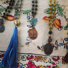 mid summer beauties; tassels and buddhas in gemtones. FInd yours here... www.litanyjewelry.com