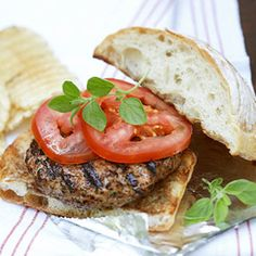 Grilled Herb Burgers  Combine lean ground beef and ground turkey with fresh herbs, chopped onion and Parmesan cheese for this fresh-tasting burger.
