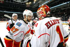 WINNIPEG, MB - MARCH Michael Frolik and goaltender Brian Elliott of the Calgary Flames celebrate a victory over the Winnipeg Jets at the MTS Centre on March 2017 in Winnipeg, Manitoba, Canada. (Photo by Darcy Finley/NHLI via Getty Images) Nhl Games, My Man, Calgary, Jets, Victorious, Centre, March, Canada, Celebrities
